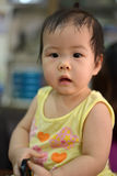 Baby look. Ing,home shot. Thai baby girl Royalty Free Stock Photo