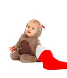 Baby look what's inside of Santa sock Royalty Free Stock Photo