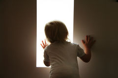 Baby is looking. Little baby is looking out of the window Royalty Free Stock Photography