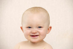 Baby looking at the camera on a peach background Royalty Free Stock Photos
