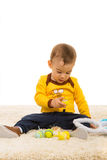 Baby looking at chicken in an egg Stock Image