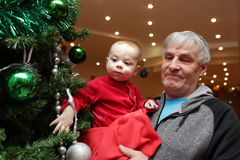Baby looking at christmas tree Royalty Free Stock Photo