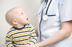 Baby looking at doctor Stock Photos