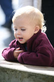 Baby looking down Royalty Free Stock Image