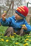 Baby looking at flower. Baby looking at yellow flower stock photos