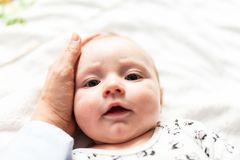 Baby looking into his mother`s eyes stock images