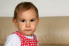 Baby looking with huge eyes into camera Royalty Free Stock Image