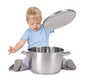 Baby looking inside saucepan Stock Photography