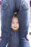 Baby looking between mother legs Stock Photos