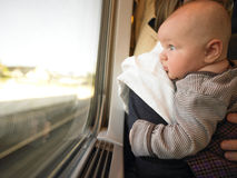 Baby Looking out Train Window Royalty Free Stock Images