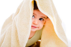 Baby looking out from under his blanket Stock Images