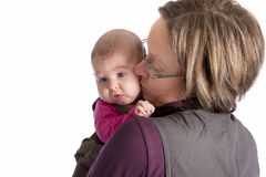 Baby looking over her mother's shoulder Stock Images