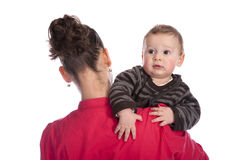 Baby looking over his mother\'s shoulder Stock Image