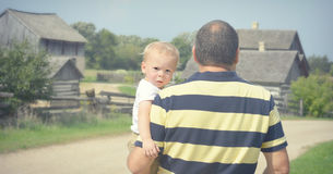 Baby Looking over Shoulder Stock Photography