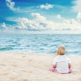 Baby looking sea Royalty Free Stock Images