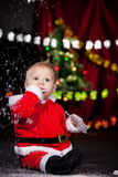 Baby looking at snow Royalty Free Stock Image