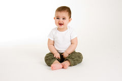 Baby Looking at Something Funny. The baby finds something funny royalty free stock image
