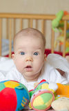 Baby looking surprised at camera. Baby with blue eyes looking surprised at camera Stock Photo