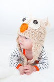 Baby Looking to the Side in Owl Hat Stock Photos