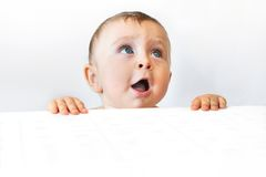 Baby looking up. Cute baby clinging to the edge, loocking up and calling  on white Stock Photos