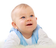 Baby looking up Stock Photo