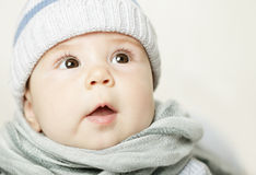 Baby looking up. Face closeup Stock Image