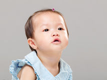 Baby looking up Stock Image