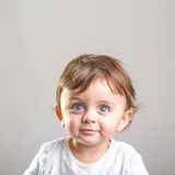 Baby looking up and smiling Royalty Free Stock Photos