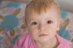 Baby looking upwards Stock Image