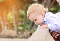 Baby looks down from a height. Safety concept. The concept of ca Royalty Free Stock Image