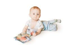 The baby looks emotionally Royalty Free Stock Photos