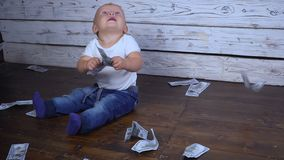 Baby and a lot of money. A small baby and a lot of money stock footage