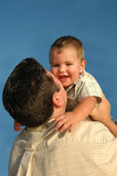 Baby Love. Father gives baby hug and kisses Stock Images
