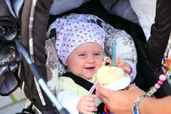 Baby loves ice-cream Stock Images