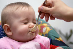 Baby at lunch time Stock Photos