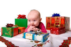 Baby Lying Amongst Christmas Gifts Stock Image