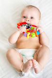 Baby lying on the back weared diaper with toy Stock Photos