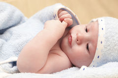 Baby lying after bath Stock Photos
