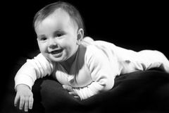 Baby lying on bed Stock Images