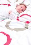Baby lying in bed Royalty Free Stock Image