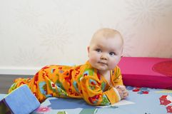 Baby lying on bed Royalty Free Stock Photography
