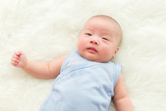 Baby lying on bed Royalty Free Stock Images