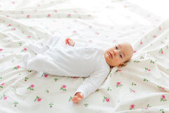 Baby lying in bed Stock Photography