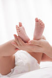 Baby lying on bed Royalty Free Stock Photos