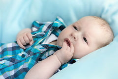 Baby lying on a blanket Stock Image