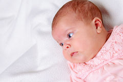 Baby lying on bright ground Royalty Free Stock Photography