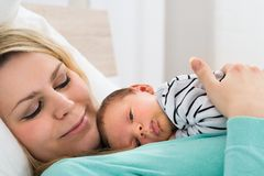 Baby lying on chest of a mother Royalty Free Stock Image