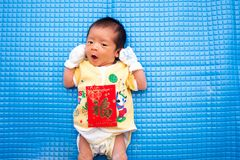 Baby Lying with Chinese Red Envelope Royalty Free Stock Photo