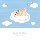 Baby lying on a cloud Royalty Free Stock Photography