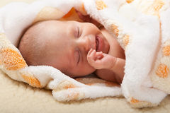 Baby lying and crying Stock Image